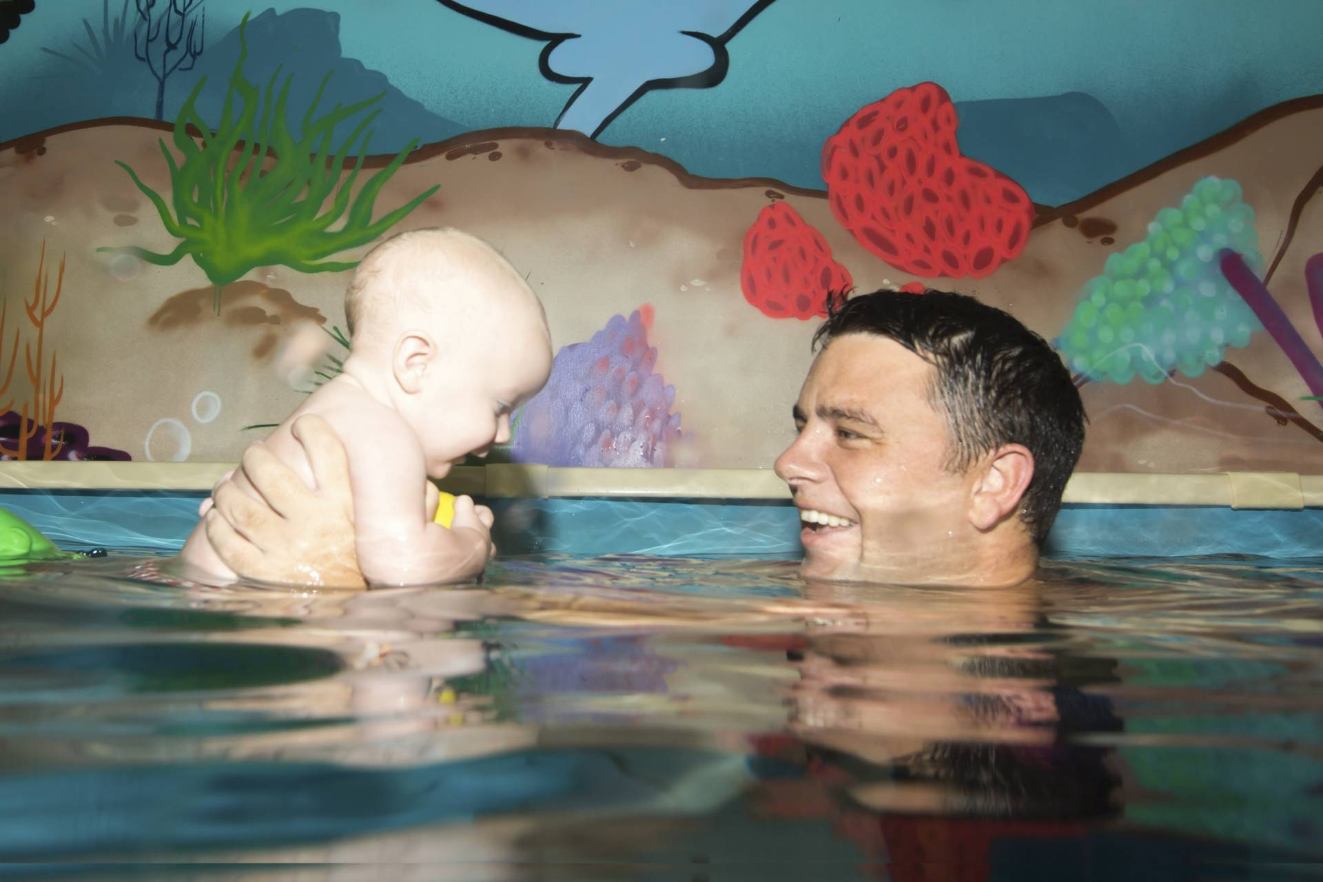 JUMP! Swim Schools managing director Ian Campbell with his three-month-old son Reed.