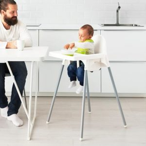 Father Watching a Toddler Sitting on IKEA ANTILOP Highchair w/ Tray While Eating